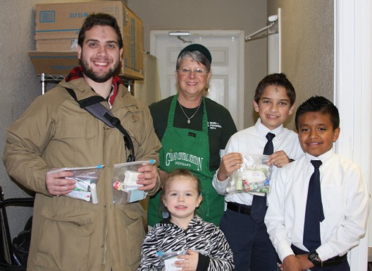 SMS students collected toiletries for the Grayson Grand Central Station Dining Car. Pictured are James Holt, GGCS volunteer Joan Smith, Mitchell Lee, Jason Garcia, and Moisann Lee.