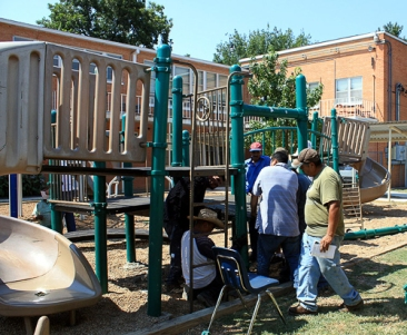The Latino group JOVENES PARA CRISTO erecting the new playground equipment at the school