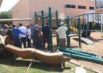 The Latino group JOVENES PARA CRISTO erecting the new playground equipment at the school
