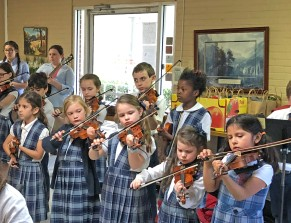handbell choir, 1st-3rd grade orchestra, and guitar class played at Denison Manor Nursing Home