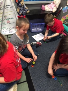 SMS First Graders used magnets to explore how they can attract and repel different objects.